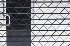 Steel mesh barriers between doors. Iron netting blocking the door between corridors Stock Photography