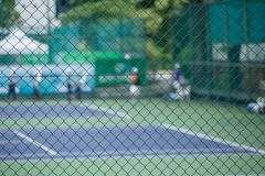 Steel mesh fence of the tennis courts Stock Photos