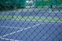 Steel mesh fence of the tennis courts Royalty Free Stock Photos