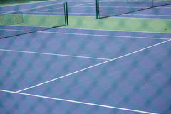 Steel mesh fence of the tennis courts Stock Photo
