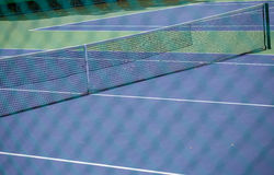 Steel mesh fence of the tennis courts Royalty Free Stock Photography