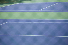 Steel mesh fence of the tennis courts Royalty Free Stock Photo