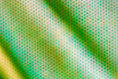 Steel mesh with green blur screen texture Stock Photos