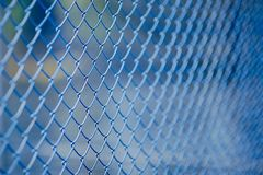 Steel mesh Rabitz. Painted blue Royalty Free Stock Photo