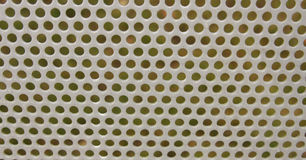 Steel Mesh Screen. Metal mesh screen outdoors with some water droplets on it royalty free stock images