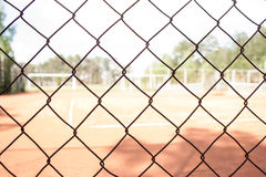 Steel mesh at tennis court Royalty Free Stock Photo