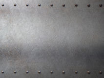 Steel metal armour with rivets background. Metal with rivets armour background or texture Stock Photography