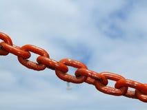 Steel metal chain links segment sky background Royalty Free Stock Photos