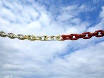 Steel metal chain links segment sky background Royalty Free Stock Photo
