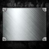 Steel metal plate on concrete wall Royalty Free Stock Images