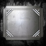 Steel metal plate on concrete wall Royalty Free Stock Photography