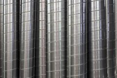 Steel or metal round pipes as industrial background, vertical pipeline ventilation tubes royalty free stock photos