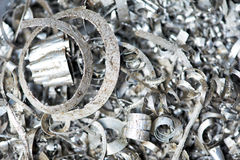 Steel metal scrap materials recycling backround. Steel scrap materials recycling backround of metal shavings Stock Photo