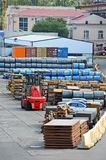 Steel metal sheet and roll in port Stock Photo