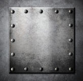Steel metal square plate or hatch with rivets Stock Image