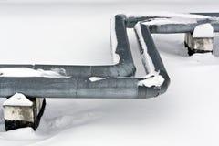 Steel metal tubes in snow. Stock Images