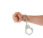 Steel metallic handcuffs on hand Royalty Free Stock Image