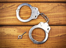 Steel metallic handcuffs Stock Images