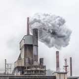 Steel mill chimney, steam and grunge Royalty Free Stock Photo