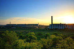 Steel mill factory. Exterior architecture of steel mill factory at sunset moment Royalty Free Stock Photos