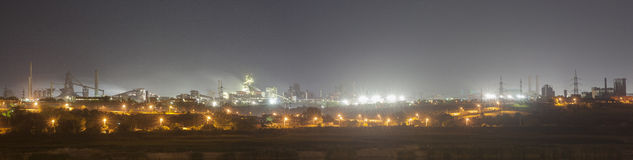 Steel mill factory by night. ArcelorMittal giant steel mill factory by night in city of Galati, Romania Stock Photo