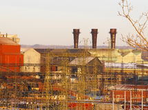Steel mill with three stacks stock photography
