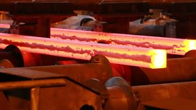 Steel mill at work. Molten steel casting and rolled steel production at metallurgical works stock video