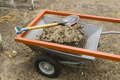 Steel modern cart, sieve for ground and metal shovel Royalty Free Stock Photography