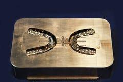 Steel molds for dentures Stock Photo