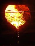 Steel, molten metal flows Stock Images