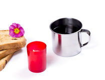 Steel mug, the red burning candle and three slices of bread Royalty Free Stock Photography