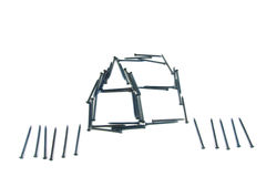 Steel nails construct house with fence. Isolate steel nails construct house with fence on white background Stock Image