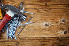 Steel nails on old wood Stock Photography