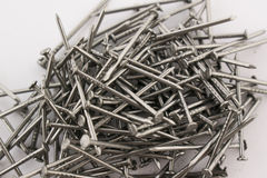 Steel nails on white background Royalty Free Stock Photography