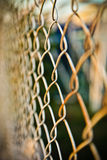 Steel net fence with blur background Royalty Free Stock Photos