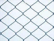 Steel net fence with blur background Stock Images