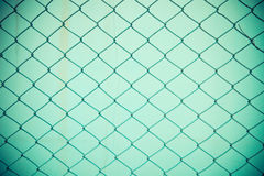 Steel net fence with blur background Stock Photos