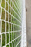Steel net fence with blur background. Net, netting, cage fence steel background border boundary gate green grid guard iron line mesh metal metallic pattern Stock Images