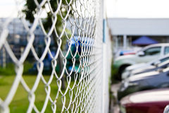 Steel net fence with blur background, Steel net fence Royalty Free Stock Photography