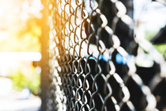 Steel net fence perspective view, selective focus with shallow depth of field Royalty Free Stock Photography