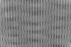 Steel net wall. Black steel net wall over concrete fence, texture background Royalty Free Stock Photography
