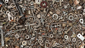 Steel nuts and bolts background Royalty Free Stock Photos