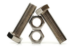 Steel nuts and bolts Royalty Free Stock Images