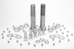 Nuts and Bolts. Steel nuts, bolts and shims  on white Royalty Free Stock Photos