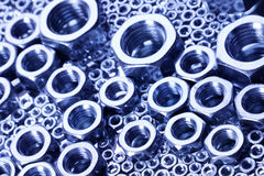 Steel nuts and screws on mirror Stock Photography