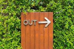 Steel out sign with arrow on wooden board Stock Image