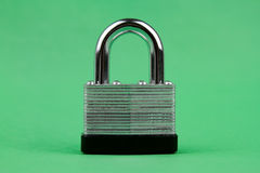 Steel Padlock on Green Background Royalty Free Stock Photography
