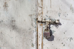 Steel padlock rustic door. Metallic steel padlock rustic door Royalty Free Stock Images