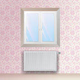 Steel panel radiator under the window. Heating equipment with thermostatic head. Royalty Free Stock Photography