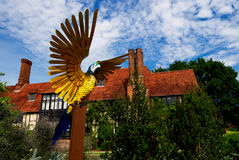 Sculpture of steel parrot with wings spread, Wisley, Surrey. Stock Photos